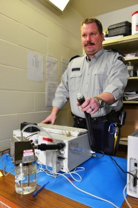 Hay River RCMP Sgt. Chad Orr demonstrates how the Intox EC/IR II breathalyzer determines a person's blood alcohol content. Results in excess of .08 lead to an impaired driving charge.  March 22, 2013 Myles Dolphin/NNSL photo