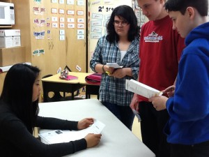 photo courtesy of Audrey Toutant  Diamond Jenness Secondary School student Angeline Magtibay, left, takes questions from Ecole Boreale students Katherine Lenoir, Graham St. John and Jake Danielsen.