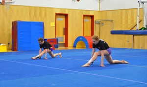 Myles Dolphin/NNSL photo Kaitlyn Ring, left and Samantha Goodwin perform their routine to the theme of Transformers at the Hay River Gymnastic Club's gymnaestrada on April 27.