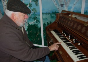 Museum Society chair Peter Osted pumps and plays the early 20th century organ that was donated to the museum and recently restored to playable condition. -- Angele Cano/NNSL photo