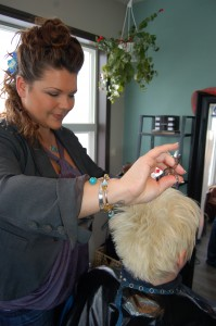 Journeyman hairstylist Melanie Boudreau puts the finishing touches on her client's cut. Angele Cano/NNSL photo