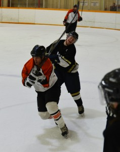 Huskies forward Curtis Rowe gets a stick in the face courtesy of Yellowknife Flyers player Chris Cahoon.  -- Myles Dolphin