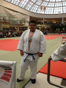 Mason Bruneau stands with his gold and silver medals, both earned at the Edmonton International Judo Championships April 5-7. -- photo courtesy of Mason Bruneau