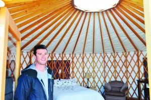 Spencer Pike of 2 Seasons Adventures stands inside one of six completed yurts at the family-owned campground. Myles Dolphin/NNSL photo