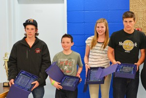 Myles Dolphin/NNSL photo Jordan Schumann, left, Trey Beck, Bryn Hill and Jeffrey Groenheyde were this year's recipients of the Keith Broadhead award, given to the player who best demonstrates the spirit of the game of hockey.