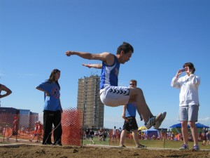 photo courtesy of Val Gendron Thomas Roche heads for a solid landing in the running long jump at the NWT Track and Field Championships in Hay River in 2012.