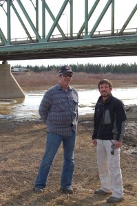 Sarah Ladik/NNSL photo Fire Chief Ross Potter, left, and Emergency Measures Organization community liaison Kevin Wallington say neither has ever seen such an uneventful breakup of the Hay River, which is especially surprising in light of the harsh winter and record snowfall. As of May 11, the West Channel was flowing freely, while the East Channel remained partly frozen.