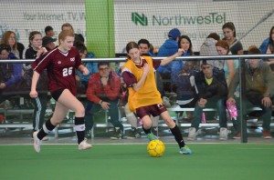 James McCarthy/NNSL photo Diamond Jenness Secondary School's Danna Webster and Ecole Boreale's Nadia Wood fight for the ball in the Super Soccer 15-and-under girls' final on May 5 in Yellowknife.