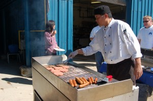 Sarah Ladik/NNSL photo The Ptarmigan Inn's Albert Gallardo worked the barbecue for a lunch on May 11 during the NWT Association of Communities' annual general meeting. The hotel catered many of the events at the conference and accommodated many delegates.