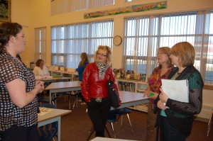 Sarah Ladik/NNSL photo Cindy Wilgosh speaks to presenter Brenda Whitton-Neary, Princess Alexandra School literacy coach Dorie Hanson, and vice-principal Carolyn Carroll after a talk on self-regulation in children on May 14.