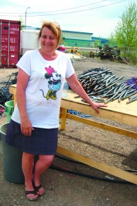 Lights On founder Jill Taylor is ready to work hard to harvest the copper that will keep the program afloat, though she says she is looking for more young people and parent volunteers to help with the massive task. -- Sarah Ladik/NNSL photo