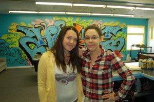 Ashleigh Haines, the youth centre's new co-ordinator, and volunteer Marissa Oteiza teamed up to make the re-opening a success. Over 20 people showed up in the first half hour alone. -- Sarah Ladilk/NNSL photo