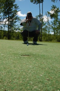 Sarah Ladik/NNSL photo Elks Lodge member Chad Orr lines up a shot at the 30th Annual Charity Golf Tournament on Saturday, June 8.