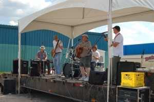 Sarah Ladik/NNSL photo Hay River band Frozen Toad plays at the Hay Days festival on June 22 on a stage set up behind the arena. The band – from left, Simon Lepage, Ron Karp, Chris Philpotts, Peter Magill and Tyler Hawkins – put on a show of northern-inspired country music.