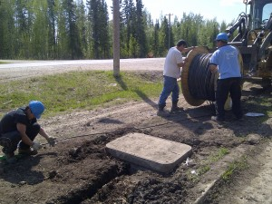 Harley Tambour, left, Henry Tambour, and Lorne Poitras lay the fibre-optic cable on the Hay River Reserve between the Band office and the KFN Daycare in 2011. -- photo courtesy of Lyle Tambour