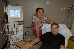 Sarah Ladik/NNSL photo Nurse Crystal Canadien helps haemodialysis patient Paul Smith at H.H. Williams Memorial Hospital on July 5. Smith and four other patients come in three times a week for the process.