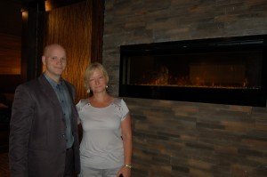 Sarah Ladik/NNSL photo Manager Curtis Rowe and owner Karen Rowe show off the new fireplace in the renovated and extensively-remodelled The Keys, a restaurant at the Ptarmigan Inn. Karen Rowe says some long-time customers remember when The Keys had a fireplace in a previous incarnation and are pleased to have the feature back once again.