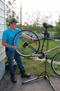 Sarah Ladik/NNSL photo Brian Burke started fixing bikes in his spare time only a few weeks ago and has already done at least a dozen repairs.