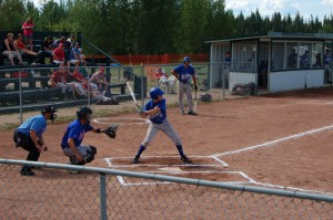 Sarah Ladik/NNSL photo Yellowknife Slades catcher Todd Morgan anticipates the pitch while Hay River Heat batter Terry Rowe winds up, and Terry Webster waits on deck.
