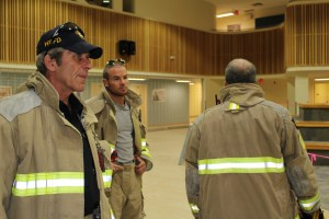 Sarah Ladik/NNSL photo Fire Chief Ross Potter, left, leads the Hay River Fire Department, including Philippe Beaupre, through a tour of the renovated facilities at Diamond Jenness Secondary School on Aug. 22. The fire department was the main proponent for the Buckle Up NWT campaign in Hay River. Potter says the department sees the consequences of not using seatbelts far too often in its ambulance service.