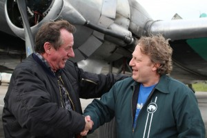 Sarah Ladik/NNSL photo Buffalo Airways president Joe McBryan, left, thanks Peter Magill for his time working for the company in Yellowknife while living in Hay River. McBryan said the 1,000 flights on a DC-3 that Magill took as part of his daily commute must surely be some sort of record.