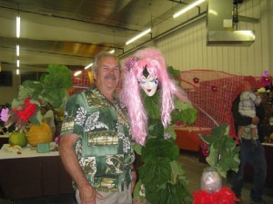 photo courtesy of Shirley King Hay River artist George Low poses with a scarecrow creation at last year's Fall Fair.
