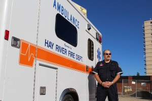 Sarah Ladik/NNSL photo Firefighter and emergency medical responder Junior Barnes stands by the Hay River ambulance after coming back from a call on Sept. 6.