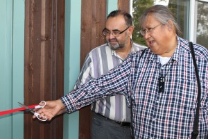 Sarah Ladik/NNSL photo Health and Social Services Minister Tom Beaulieu, left, and Chief Roy Fabian cut the ribbon to officially open the K'atlodeeche First Nation Anne Buggins Wellness Centre on Sept. 5 on the Hay River Reserve.