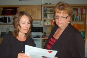 NNSL file photo Money coach Shelley Maher, left, and the Royal Bank's Leah McFarlane plan for a workshop and information session about talking to kids about money on July 29 at the Hay River Community Learning Centre of Aurora College.