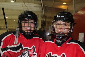 Jill Belanger, left, and Rachel Harder get ready to step onto the ice for the Hockey Canada girls' long-game in Hay River Oct. 12. -- Sarah Ladik/NNSL photo