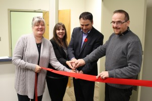 Sarah Ladik/NNSL photo Cutting the ribbon on Nov. 8 to open the new offices in Hay River for the Business Incentive Policy are, from left, Hay River South MLA Jane Groenewegen; office manager Kim Wilkins; Industry, Tourism, and Investment Minister David Ramsay; and Hay River North MLA Robert Bouchard.