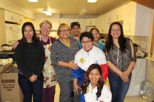 From left, Lennie Ramirez, Sister Maggie, Tessie Gonzales, Kelly Lizardo, Lilia Alcos, Sheila Domingo (front), Julita Bordey, and Delaila Thomson ran the kitchen Nov. 30 at the fundraising dinner for the typhoon-ravaged Philippines at the Catholic church. Photo by Sarah Ladik NNSL