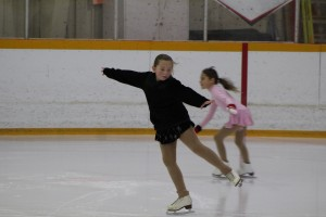 Kynidi Robillard lands from an element while practising for her skating test while Jenna Demarcke skates past at the Don Stewart Recreation Centre Nov. 30. Photo by Sarah Ladik NNSL