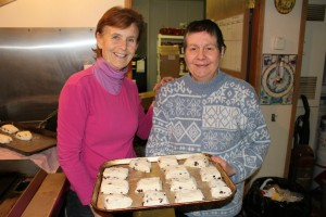 Volunteer Lottie Ericson, left, helps Soup Kitchen co-ordinator Laura Rose make bannock laced with fruit on Dec. 2.
