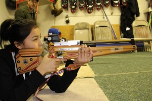 Tyra Manuel-Drybones from Fort Good Hope sets up for a shot at the indoor range at the Hay River Ski Club on Dec. 12. For safety reasons, the athletes used air rifles firing pellets instead of their usual 22-calibre rifles. -- Srah Ladik/NNSL photo