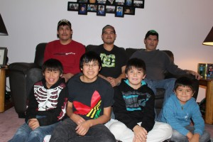 With the help of donations from the community, three Hay River brothers – from left, back row: Shone, Rene and Donald Beaulieu – are taking their families, including from left, front row: Seth, Shade, Ziggy and Brody Beaulieu, to see the brothers' mother, Irene Beaulieu, in Edmonton for Christmas. Irene Beaulieu remains in hospital after being struck by a vehicle in Hay River in November. -- Sarah Ladik/NNSL photo