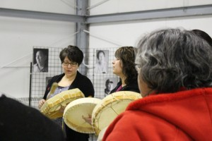 From left, in the background, Jacqueline Carriere and Jessie Carriere help lead the drumming circle at the Soaring Eagle Friendship Centre Jan. 12. Photo by Sarah Ladik NNSL