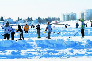 Players flock from all over the South Slave and northern Alberta to play on the multiple rinks built on the frozen Hay River in March. Photo courtesy of Jason Coakwell