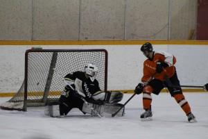 Huskies goalie Connor Goudreau makes a save in the third period at the Northern Hockey Challenge game against the Yellowknife Flyers Jan. 18. Photo by Sarah Ladik NNSL
