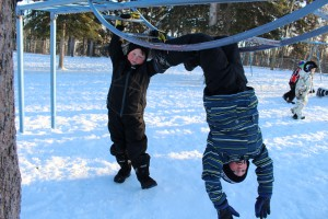 Bert Buckley Jr., left, and Caleb Swan show off on the monkey bars on a warm afternoon Jan. 16. Photo by Sarah Ladik NNSL