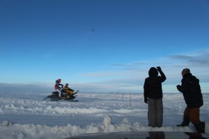 Spectators cheer on racers at the course built out on the frozen lake at 2 seasons campground Jan. 25. Photo by Sarah Ladik NSSL