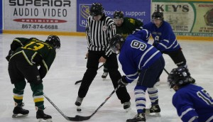 Players from Yellowknife and Hay River face off at the Old Timers' hockey tournament Feb. 1 at the Don Stewart Recreation Centre. Photo by Sarah Ladik NNSL