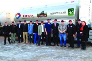 Members of both Total Canada and Bassett Petroleum teams joined to mark the signing of the multi-year deal that will see Total lubricant products distributed for the first time in Western Canada. From left, Christopher Amenda, Robin Patey, Qaiser Qureshi, Craig Zelizney, Peter Lane, Shawn Furlong, Laurent Siret, Norm Bassett, Stephen MCGarvie, Steve Bassett, Hector Lopex, Tony McEwen, and Gail Marshall. Photo courtesy of National Public Relations