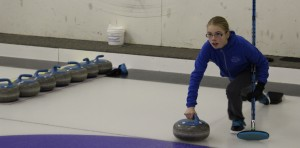 Nicole Griffiths throws a rock at the NWT School Curling Championship in Hay River Feb. 8. Photo by Sarah Ladik NNSL