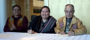 Signing of memorandum of understanding on forest resources in Fort Resolution area. Chief Louis Balsillie of Deninu Ku'e First Nation, left, president of the Fort Resolution Metis Council Kara King, minister of Environment and Natural Resources Michael Miltenberger. Feb. 19, 2014 Yellowknife Photo courtesy of the GNWT