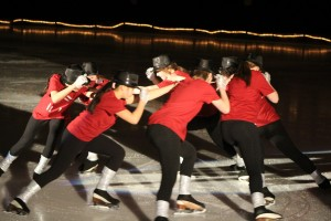 "Skaters perform a number set to Michael Jackson's hit ""Beat It"" at the annual Skating Carnival March 29."