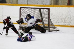 The goalie for both Hay River teams, Owen Pettipas, makes a save against the team from Rainbow Lake Alta March 1 at the Don Stewart Recreation Centre.