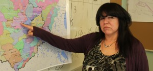 Adult educator at Cheif Daniel Sonfrere Education Centre Shirley Bonnetrouge points to Hay River on a map of the territory's watersheds. She is scared the waterways will be unprotected after devolution April 1. Photo by Sarah Ladik NNSL