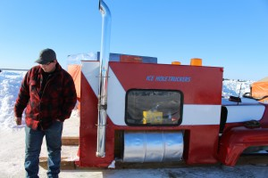 Sarah Ladik/NNSL photos Chad Plamondon stands with the so-called shack he helped construct for the ice fishing derby event March 15. The structure ended up taking the title for best hut.
