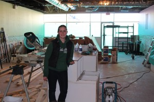 Melissa Beck stands where the counter will be in the new space She Takes the Cake will be inhabiting as of mid-April. She says the cafe will be just as cozy and welcoming as before, but with a touch more sophistication. Photo by Sarah Ladik NNSL